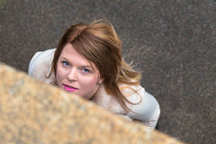 Top view of a beautiful girl posing in an urban context Royalty Free Stock Photography