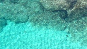 Top view of beautiful turquoise ripple on the sea surface and seabed via crystal clear blue water. stock footage