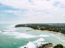 Top view of beautiful white sand beach with turquoise sea water long shot royalty free stock photos