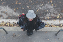 Top view of a beautiful young brunette posing in the city streets Royalty Free Stock Photography