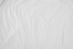 Top view of bedding sheets crease,white fabric wrinkled texture. Top view of bedding sheets crease,white fabric texture soft focus Royalty Free Stock Photos