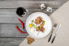 Top view beef tartar of raw minced meat restaurant served on white plate and glass of red wine on table, gray background. Space for text menu. Restaurant Stock Photos