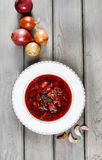 Top view on beetroot soup on old wooden table Stock Images