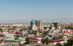 Top view of the Bibi-Khanym mosque. Top view of the monument Bibi-Khanym mosque amid a residential district with one-story buildings. Samarkand, Uzbekistan stock photography