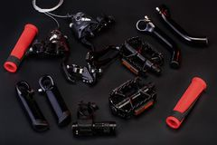 Top view of bicycle parts on black background stock image