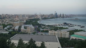 Top view of a big city by the sea. Day to night. Baku, Azerbaijan. Time Lapse stock video footage
