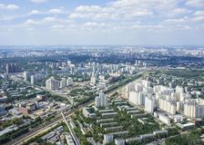 Top view of big city in the summer. Urban panorama of cityscape and blue sky Royalty Free Stock Photos