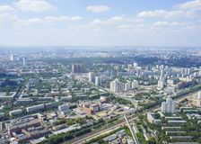 Top view of big city in the summer. Urban panorama of cityscape and blue sky, groups of buildings Royalty Free Stock Image