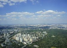 Top view of big city in the summer. Urban panorama of cityscape and blue sky. Residential neighborhoods offices and office buildings Stock Image