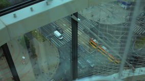 Top view of the Big CrossRoad with Cars, Tram, Cyclist, People, and Houses stock video footage