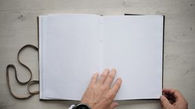 Mans hands open handmade a4 notebook with real leather cover stock video