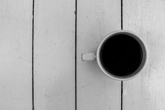 Top view of black coffee cup on white wooden table Stock Images