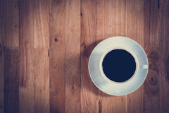 Top view of black coffee in the cup on wooden table Stock Image