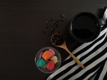 Top view of black coffee with morning desserts on the black dining table. royalty free stock photo