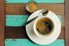 Top view of a black coffee in white cup with sugar on old wood. Top view of a black coffee in white cup with sugar on old wood background Royalty Free Stock Photo