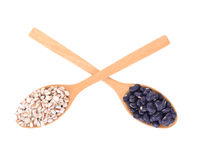 Top view of black eyed peas beans and millet grains in wooden sp Royalty Free Stock Photo