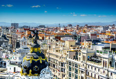 Top view and black and golden angel in Madrid, Spain in May 2014. Madrid city and mountains from the bird`s eye view of bar terrazza Stock Photos