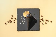 Top view of black ice cream. On yellow stock photo