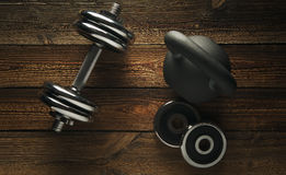 Top view of black iron kettlebell, dumbbell on wooden floor Spor. T background with copyspace  Weight lifting exercise concept Stock Photography