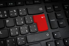 Top view of black keyboard with red Enter button. Cyber crime concept Stock Photography