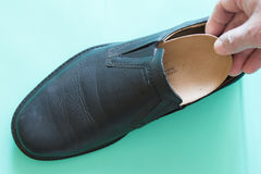 Top view of black leather shoes with orthopedic insoles. Neutral Stock Photo