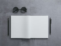 Top view of black notepad with pen and hipster glasses on concrete background. identity branding element. 3d rendering Stock Images