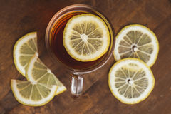 Top view of black tea with lemon in cup and on wooden plank table Royalty Free Stock Photos