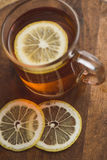 Top view of black tea with lemon in cup and on wooden plank table Stock Photos