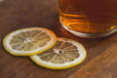 Top view of black tea with lemon in cup and on wooden plank table Stock Image