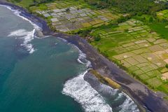 Arial view of black volcanic sandy beach in Bali, Indonesia stock photography