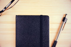 Top view on blank black diary with pen and eyeglasses Royalty Free Stock Photos