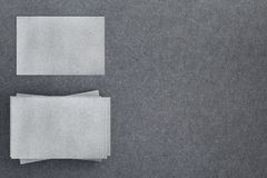 Blank business cards top. Top view of blank business/visiting cards on textured concrete background. Mock up, 3D Rendering stock illustration