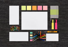 Top view of blank colorful stationery mock up on black office de Stock Image