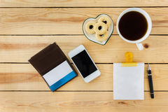 Top view blank memo note pad with pen and coffee. Blank memo note pad with pen and coffee, top view coffee and things on wooden table royalty free stock photos
