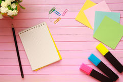 Top view of blank notebook page on pastel colored background office desk with different objects. Minimal flat lay style Stock Images
