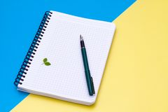 Top view on a blank notebook with pen flat lay Stock Images