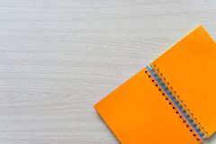 Top view of Blank notebook on wood background with copy space royalty free stock images