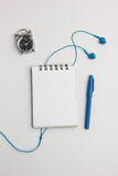 Top view of blank notepad with headphones Stock Images