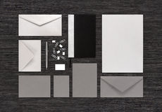 Top view of blank stationery and branding corporate identity mock-up on black office table stock images