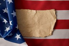Top view of blank vintage crumpled paper on american flag stock images
