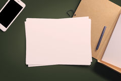 Top view of blank white paper sheet. With office tools. Workspace mock up Stock Image