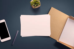 Top view of blank white paper sheet. With office tools. Workspace mock up Royalty Free Stock Images