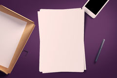 Top view of blank white paper sheet. With office tools. Workspace mock up Royalty Free Stock Photos