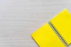 Top view of Blank notebook on wood background with copy space royalty free stock photos