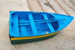 A top view on a blue boat with a paddle, Madeira ilsland Portugal. A top view on a blue boat with a paddle, Funchail Portugal stock photography