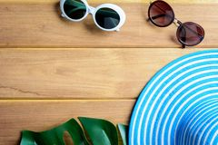 Free Top View Blue Hat And Sunglasses On A Wooden Table Stock Photos - 103188353