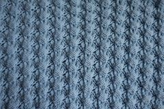 Top view of blue knitted fabric with relief pattern. Top view of light blue knitted fabric with relief pattern stock photography