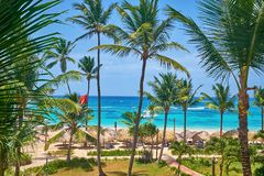 Top view of the blue ocean palm trees and thatched roofs royalty free stock images