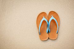 Top view blue sandal on the beach with copy space concept time to travel Royalty Free Stock Photos