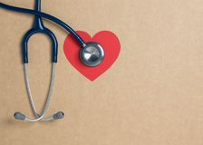 Top view blue stethoscope on yellow background. For check heart or health check up concept stock images